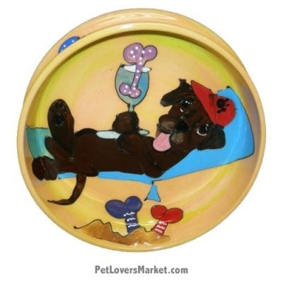 Chocolate Labrador Dog Bowl (Hersey Louie). Ceramic Dog Bowls; Designer Dog Bowls; Cute Dog Bowls. Dog Bowls are Made in USA. Hand-painted. Lead Free. Microwave Safe. Dishwasher Safe. Food Safe. Pet Safe. Design features Chocolate Labrador dog breed suntanning at dog beach with beach chair.