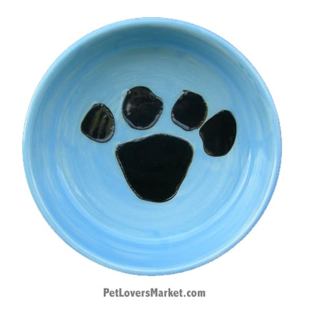 Blue with Black Paw Print. Part of Collection of Ceramic Dog Bowls; Designer Dog Bowls; Cute Dog Bowls. Dog Bowls are Made in USA. Hand-painted. Lead Free. Microwave Safe. Dishwasher Safe. Food Safe. Pet Safe.