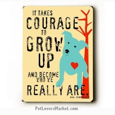 It takes courage to grow up. Wooden signs with quotes.